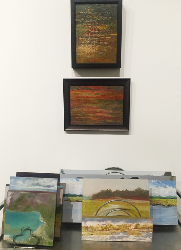 "Oils on panel at Jericho Arts (from top) Reflections 9"" x 12"", Smolder 9"" x 12"", and assorted unframed paintings"