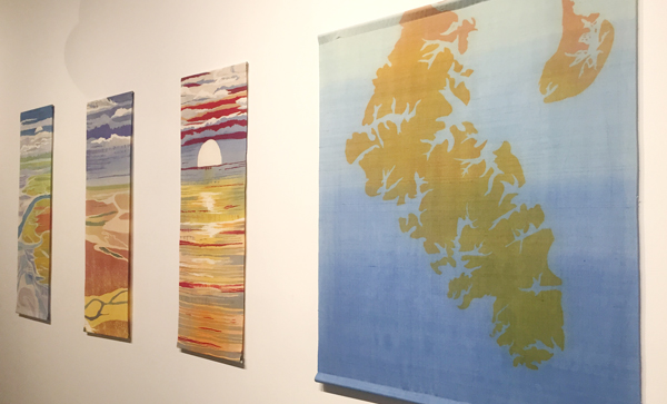 "Batiks on silk at Jericho Arts (from left) Edisto V 42"" x 14"", Over the ACE 42"" x 14"", Supermoon 41"" x 14"", and Historic Charleston 42"" x 34"""